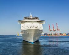 A luxury cruise liner leaving port Stock Photos