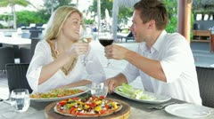Couple Enjoying Meal In Outdoor Restaurant - stock footage