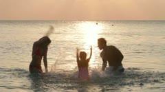Silhouette Of Family Having Fun In Sea Stock Footage