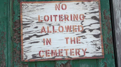 No loitering in cemetery sign Stock Footage