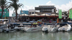 Pier in the village of Latchi for boarding of tourists on cruise ships. Cyprus Stock Footage