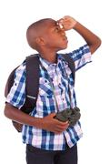 african american school boy holding binoculars - black people - stock photo