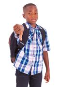 African american school boy making thumbs down - black people Stock Photos