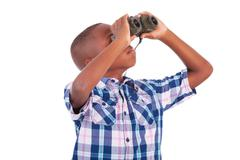 african american boy using binoculars - black people - stock photo