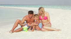Family Making Sandcastle On Beach Holiday Stock Footage