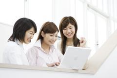 Women Looking at Computer Screen - stock photo