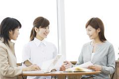 Three Women in Meeting - stock photo