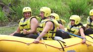 Group of young people training for rafting, out of the water Stock Footage