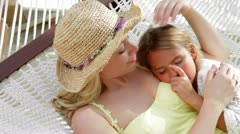 Mother And Daughter Relaxing In Beach Hammock Stock Footage