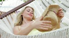 Woman Relaxing In Beach Hammock Stock Footage
