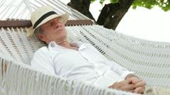 Senior Man Relaxing In Beach Hammock - stock footage
