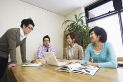 Four People in Meeting - stock photo