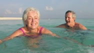 Senior Couple Relaxing In Tropical Sea Stock Footage