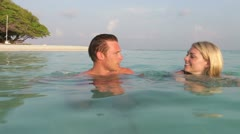 Couple Relaxing In Tropical Sea - stock footage