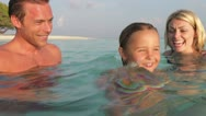 Family Relaxing In Tropical Sea Stock Footage