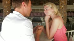 Man Proposing To Woman In Restaurant Stock Footage