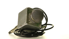 Journalist's microphone on a white background loop Stock Footage