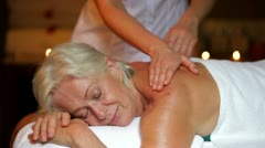 Senior Woman Having Massage In Spa Stock Footage