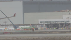 Long Hazy Telephoto shot of an airplane taxing Stock Footage