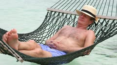 Senior Man Relaxing In Beach Hammock - stock footage