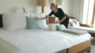 Stock Video Footage of Hotel Chambermaid Making Guest Bed