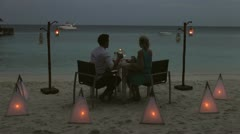 Couple Enjoying Late Meal In Outdoor Restaurant - stock footage