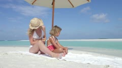 Mother Protecting Daughter With Sun Lotion On Beach Holiday - stock footage
