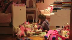 Time-Lapse Sequence Of Girl Moving Toys To Make Bed On Floor Stock Footage