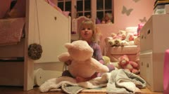 Time-Lapse Sequence Of Girl Playing With Toys In Bedroom Stock Footage