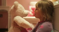 Girl Giving Teddy Bear Hug Whilst Wearing Pajamas Stock Footage