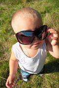 Boy with sunglasses Stock Photos