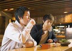 Man Having Drinks in Japanese Style Pub - stock photo
