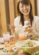 Woman in Japanese Style Pub - stock photo