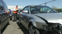 Loss Adjuster Inspecting Car Involved In Accident Stock Footage