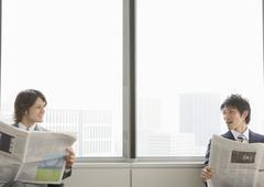 Businessmen reading a newspaper Stock Photos