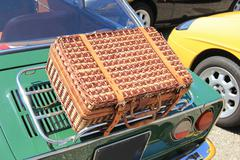 Wicker luggage on a classic car Stock Photos