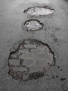 Potholes / road damage Stock Photos