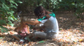 Mother, Child make Mask in Leaves in Forest, Little Girl Playing in Wood, Family Footage