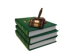 Stack of law books and gavel Stock Photos