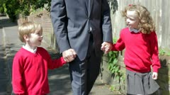 Father Walking To School With Children On Way To Work - stock footage