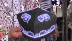Woman folds traditional Uzbek skullcap, muslim, Islam, Central Asia Stock Footage