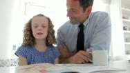 Stock Video Footage of Father Helping Daughter With Homework In Kitchen