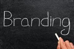 Branding, written on a blackboard. - stock photo