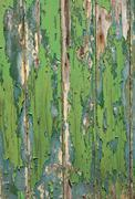 Green and blue color peeling paint texture wooden fence. Stock Photos