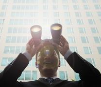 Young Businessman Using Binoculars and Looking, Lens Flare Stock Photos