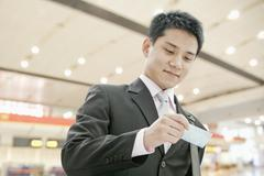 Businessman Checking the Ticket - stock photo