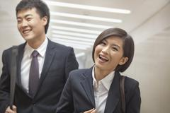 Two Business People Walking Together - stock photo