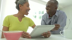 Mature African American Couple Using Digital Tablet At Home - stock footage