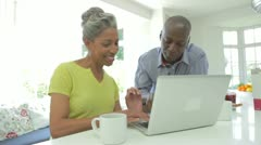 Stock Video Footage of Mature African American Couple Using Laptop At Home