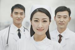 Portrait of Healthcare workers in China, Two Doctors and Nurse - stock photo